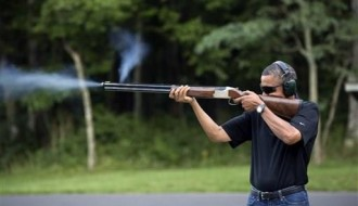 Image of White House releases photo of Obama firing gun